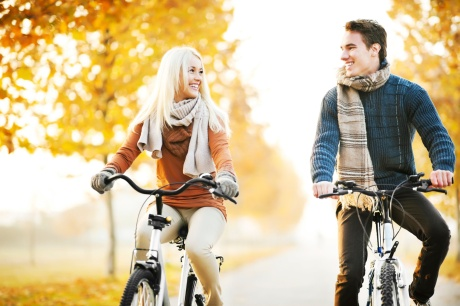 Beautiful day in the park, two young people riding bikes.[url=http://www.istockphoto.com/search/lightbox/9786786][img]http://dl.dropbox.com/u/40117171/couples.jpg[/img][/url]